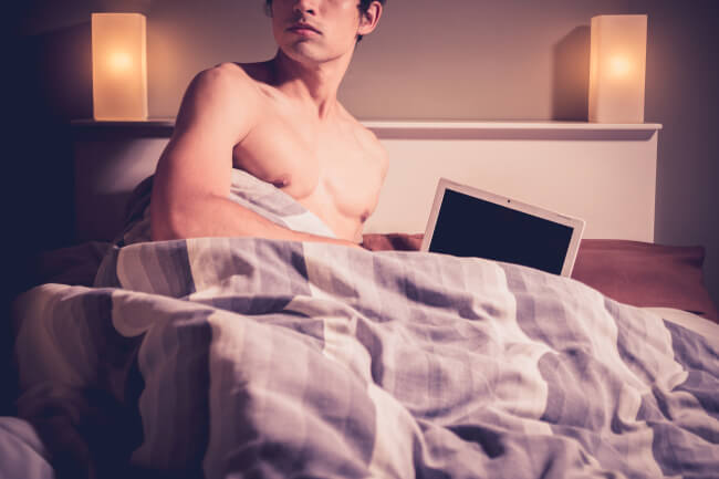 Man in bed with a computer
