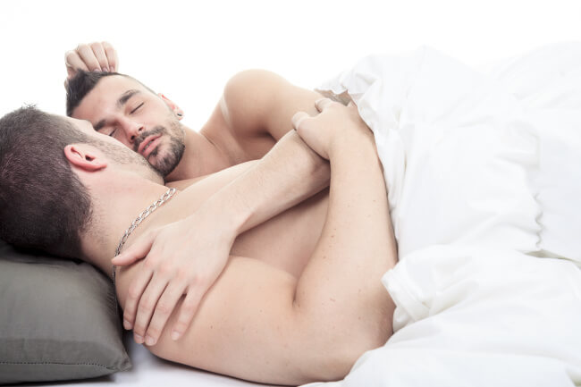Two men in bed
