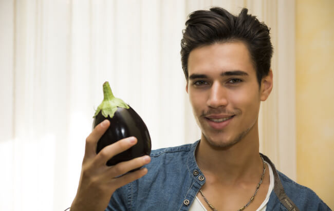 Man holding eggplant. Too big?