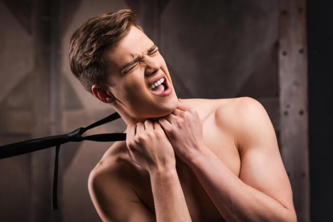 Man choking with tie