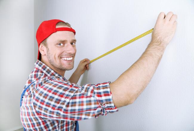 Man holding a ruler