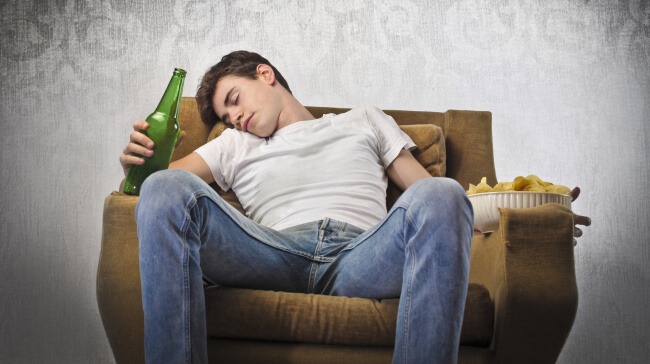 Drunk man sleeping on the couch