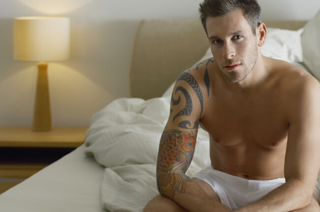 Man in underwear on the bed