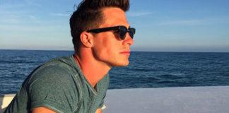 Colton Haynes looking at the ocean