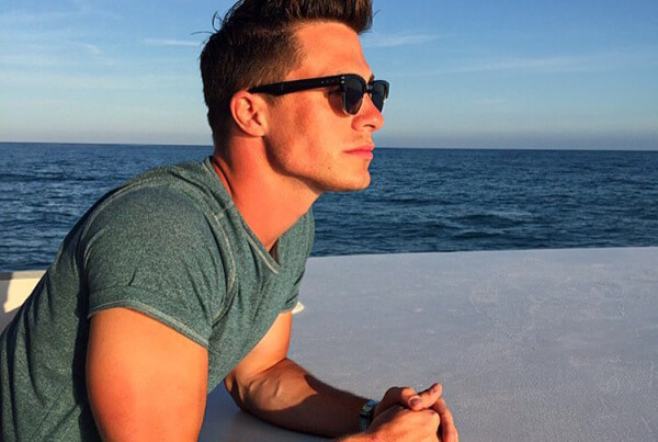 Colton Haynes looking at the ocean