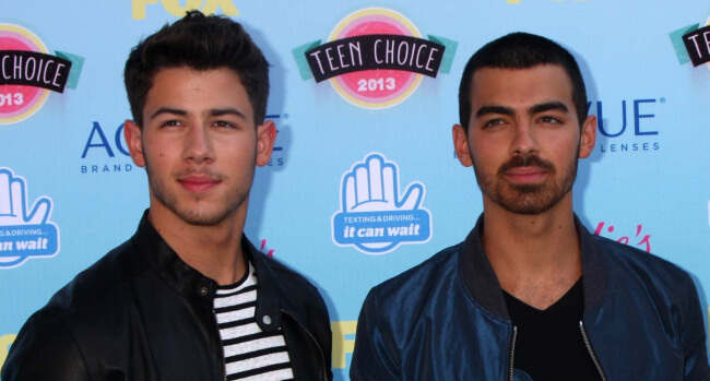 Nick Jonas Asked To Reveal: Which Jonas Brother Is Bigger… Down There?