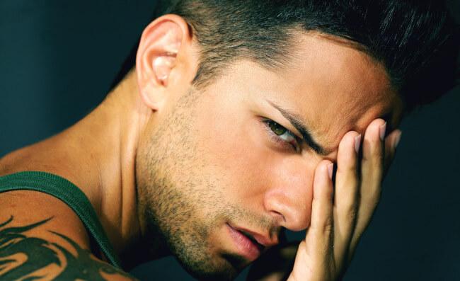 Man with headache and black eye