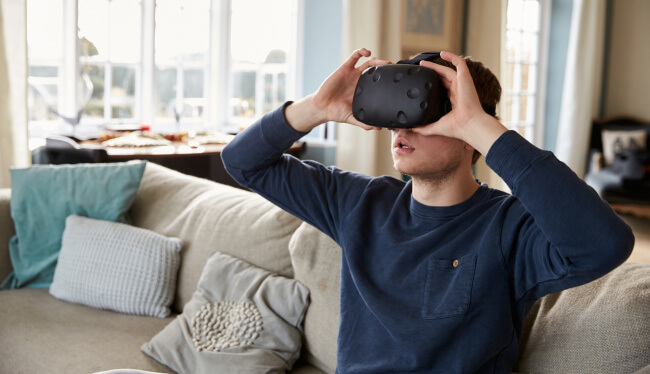 Man with virtual reality headset watching gay porn