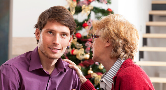 Man with mother and a Christmas tree