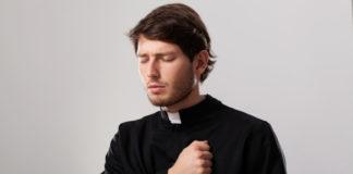 Young sad priest pastor