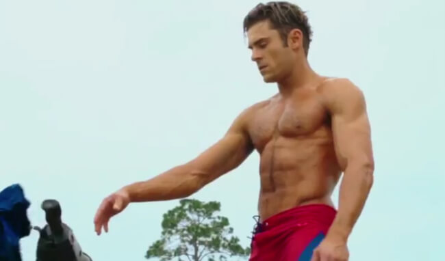 Zac Efron Shows His Perfect Washboard Abs, And Gets Them All Wet In New Trailer