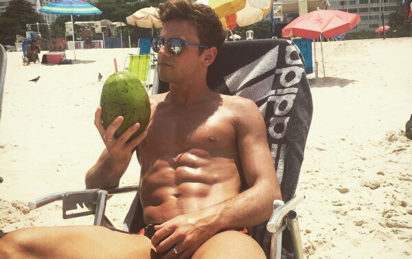 Tom Daley on the beach