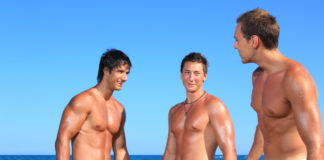 Three men on the beach