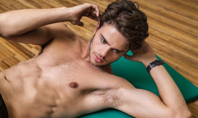 shirtless man at the gym