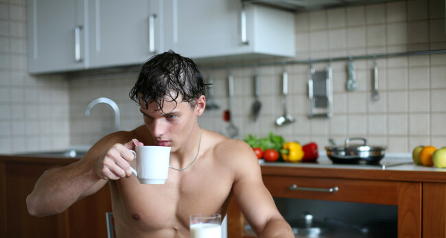 Man drinking tasting breakfast