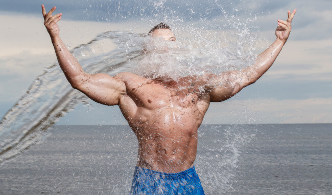 Man getting wet on the beach