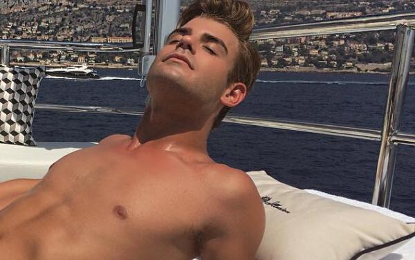 Garrett Clayton tanning