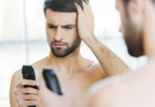 Man holding electric shaver grooming