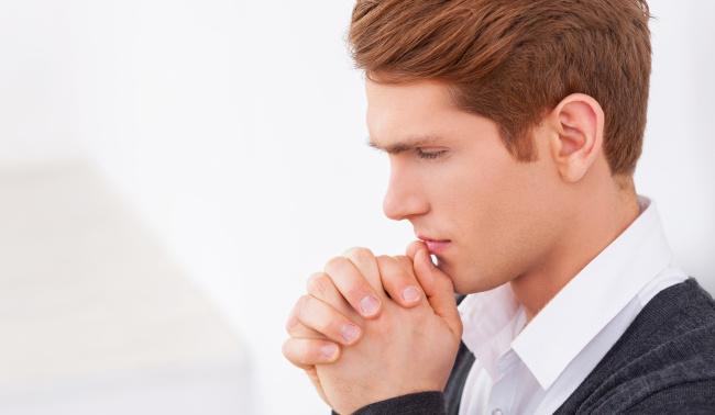Man holding hands praying