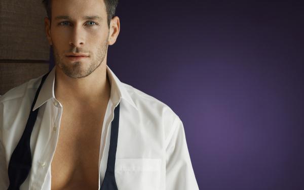 Man serious unbuttoned shirt