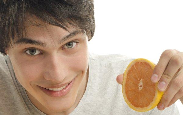 Man holding an orange