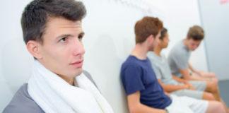 Man in locker room with friends