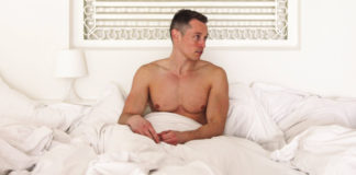 Davey Wavey in hotel bed