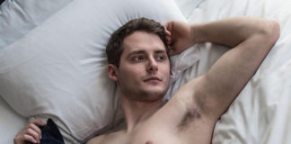 Zachary Howell naked in bed