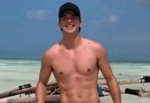 River Viiper shirtless on the beach